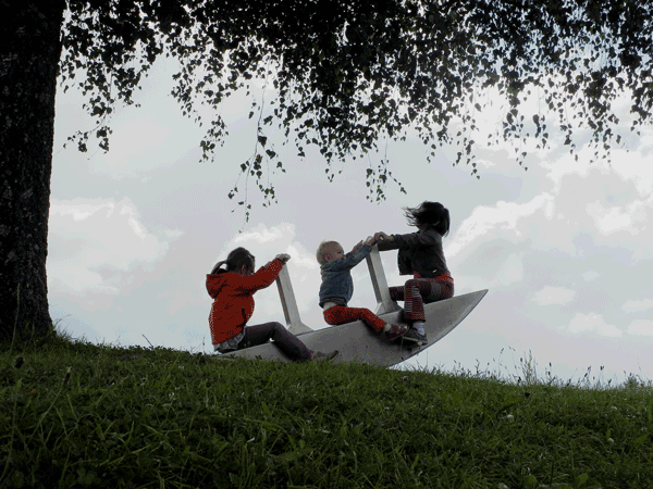 kids-playing-on-see-saw