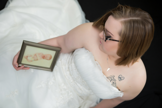 """I donated my wedding dress to be made into Gowns for deceased infants to be buried in. I had pictures done in my dress before I donated it. This is one of my favorites."" - Kaila Flory"